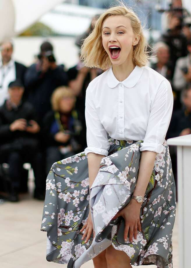 """Rude gust:Canadian actress Sarah Gadon battles a Marilyn Monroe-style updraft during a photo call for """"Maps to   the Stars"""" at the Cannes Film Festival in France. Photo: Valery Hache, AFP/Getty Images"""