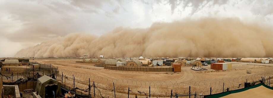 Sand blasts Bastion: A sand storm approaches Camp Bastion, Britain's main military base in Afghanistan. Photo: Cpl Daniel Wiepen RLC, Getty Images