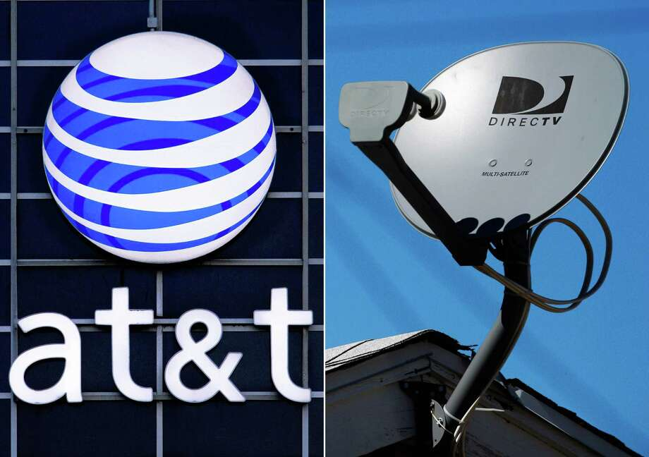 This combo made from file photos shows the AT&T logo on the side of a corporate office in Springfield, Ill., left, and a DirecTV satellite dish atop a home in Los Angeles. Priming itself for the age of Internet-delivered video, AT&T Inc. on Sunday, May 18, 2014 said it would buy DirecTV for $48.5 billion in cash and stock, or $95 per share. (AP Photo) Photo: Seth Perlman, Reed Saxon, STF / AP