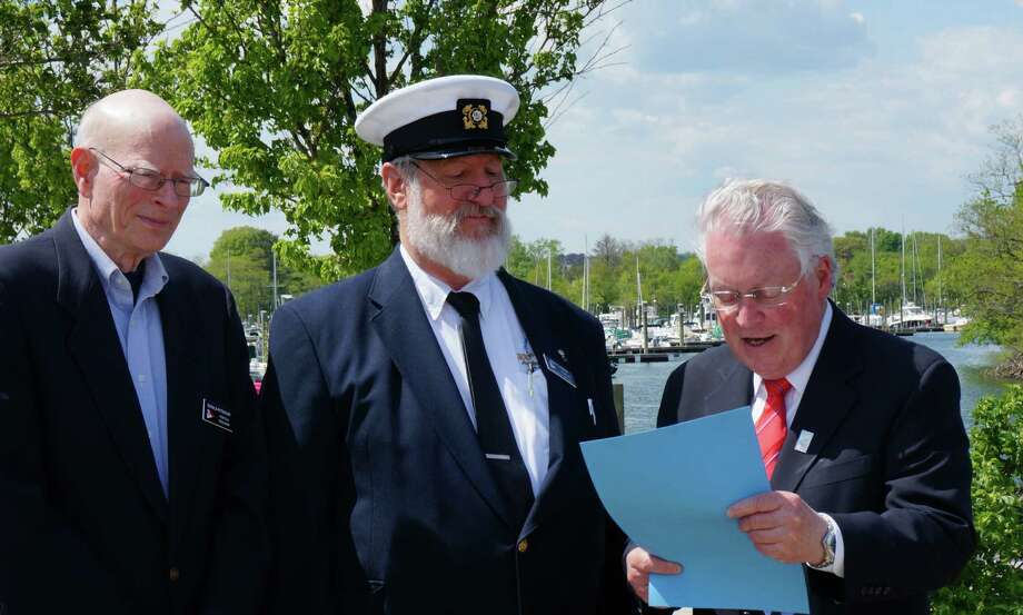 First Selectman Mike Tetreau, far right, reads a proclamation recognizing the Penfield Power & Sail Squadron during Safe Boating Week Monday at the South Benson marina. From left, Don Peterson, squadron treasurer and John Pyrch, squadron commander. Photo: Genevieve Reilly, Tim Loh / Fairfield Citizen