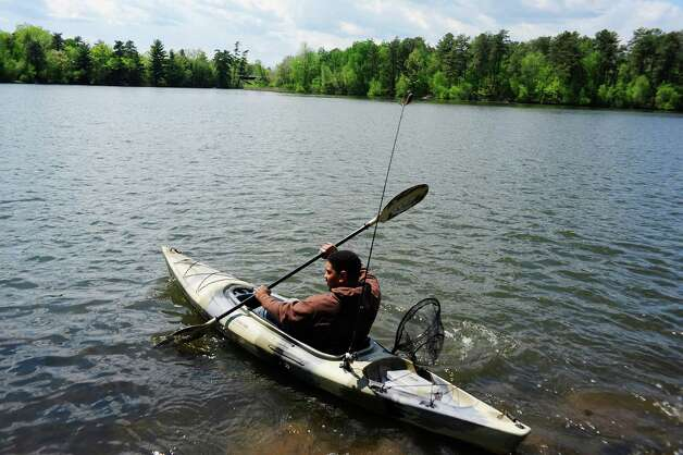 Josue Colon of Watervliet paddles out onto Rensselaer Lake for some fishing on Monday, May 19, 2014, in Albany, N.Y.  (Paul Buckowski / Times Union) Photo: Paul Buckowski