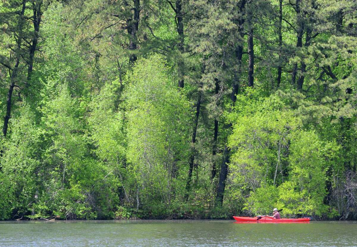 A kayaker paddles along the shoreline at Rensselaer Lake on Monday, May 19, 2014, in Albany, N.Y. (Paul Buckowski / Times Union)