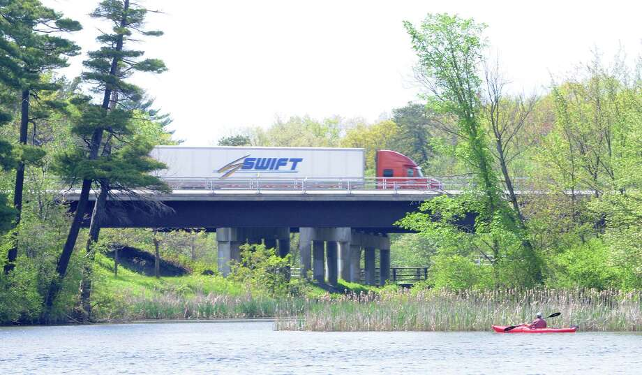 A kayaker paddles along the shoreline at Rensselaer Lake as traffic zips by on Interstate 87 on Monday, May 19, 2014, in Albany, N.Y.  (Paul Buckowski / Times Union) Photo: Paul Buckowski