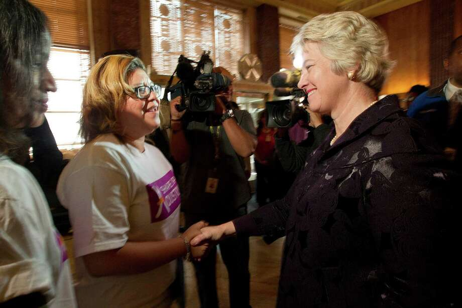Mayor Annise Parker talks with Griselda Garza, an administrative assistant for the City of Houston after Parker announces a new partnership with Shape Up Houston at City Hall Wednesday, Jan. 29, 2014, in Houston.  Garza has lost 50 pounds as she has lead a group of city employees as a fitness instructor. Parker and other partner businesses including H-E-B are encouraging businesses and their employees to participate in loosing 1 million pounds of weight through healthy eating and exercise. To participate in the challenge visit http://www.shapeuphouston.org  ( Johnny Hanson / Houston Chronicle ) Photo: Johnny Hanson, Staff / © 2014  Houston Chronicle