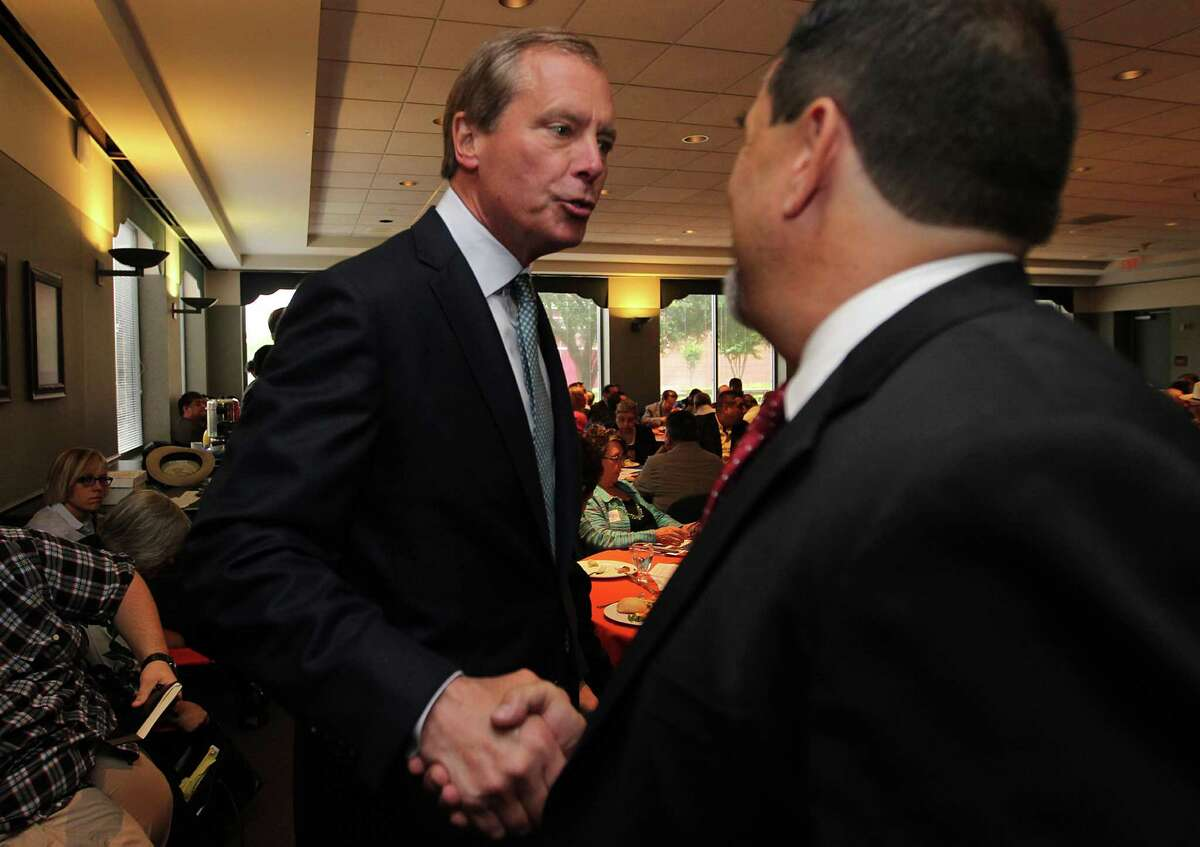 Lt. Governor David Dewhurst shakes republican supporters hands at the Houston Community Pastors forum Thursday May 8, 2014 at Houston Baptist University. ( Billy Smith II / Houston Chronicle)