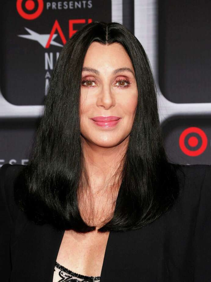 """FILE - This April 24, 2013 file photo shows performer Cher at the AFI Night at the Movies at the ArcLight in Los Angeles. Cher will be performing on the singing competition series """"The Voice"""" during the season finale on Tuesday, June 18.  She will perform A'A""""WomanA'A's WorldA'A"""" the first single off of her upcoming album. (Photo by Todd Williamson/Invision/AP, file) Photo: Todd Williamson / Invision"""