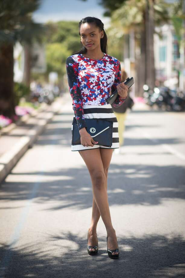 Emilie Joseph is wearing a top from Peter Pilotto, shorts from Asos as well as shoes and  a bag from Carmen Steffens on the streets of Cannes during the 67th Annual Cannes Film Festival on May 15, 2014. Photo: Timur Emek, French Select Via Getty Images