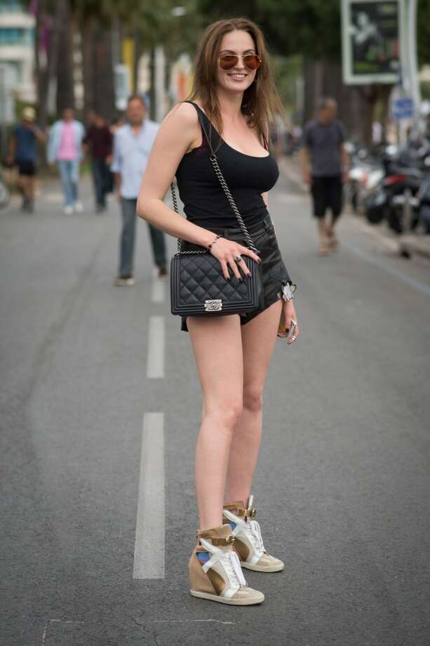 Alyona Mazurenko is wearing shorts from Natasha Zinko, a bag from Chanel and shoes from Sherzo Rossi on the streets of Cannes during the 67th Annual Cannes Film Festival on May 16, 2014. Photo: Timur Emek, French Select Via Getty Images