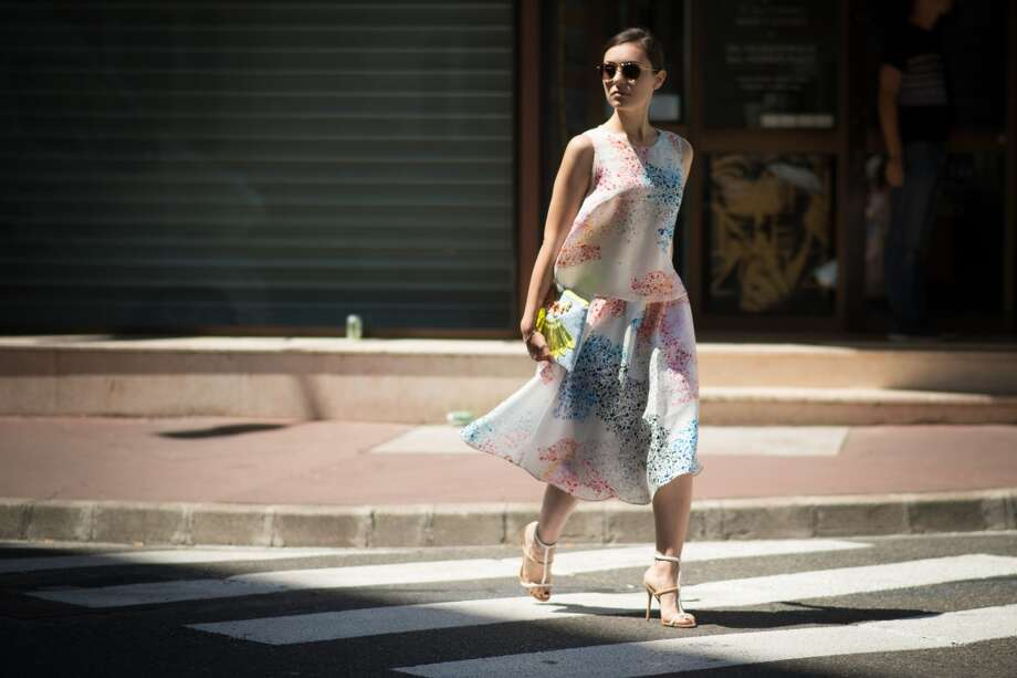 Marta Pozzan is wearing a dress and a top from Tanya Taylor, shoes from Nasty Gal, a bag from  Mawi and sunglasses from G-star on the streets of Cannes during the 67th Annual Cannes Film Festival on May 18, 2014. Photo: Timur Emek, French Select Via Getty Images