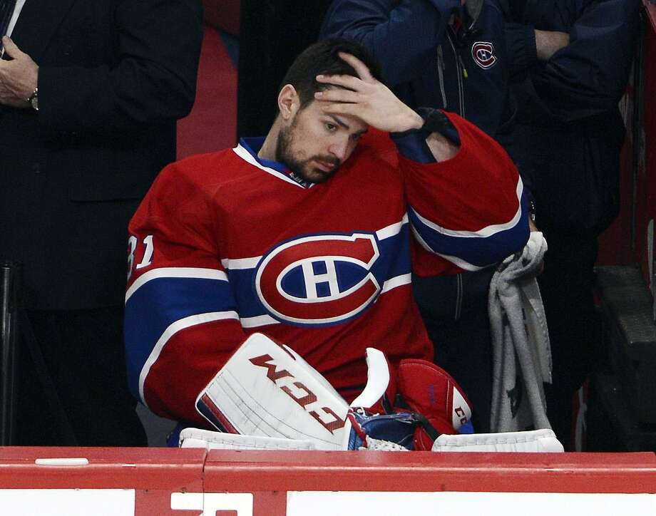 Montreal's Carey Price watches from the bench in Game 1 after being removed at the end of the second period. Photo: Ryan Remiorz, Associated Press
