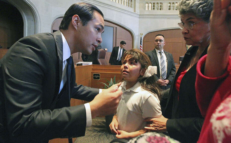 A tearful Valeria Araujo, 7, of the Mission Trails mobile home park listens to Mayor Julián Castro as he tries to console her after she was told her family was going to have to move after a zoning change vote May 15. Photo: Tom Reel / San Antonio Express-News