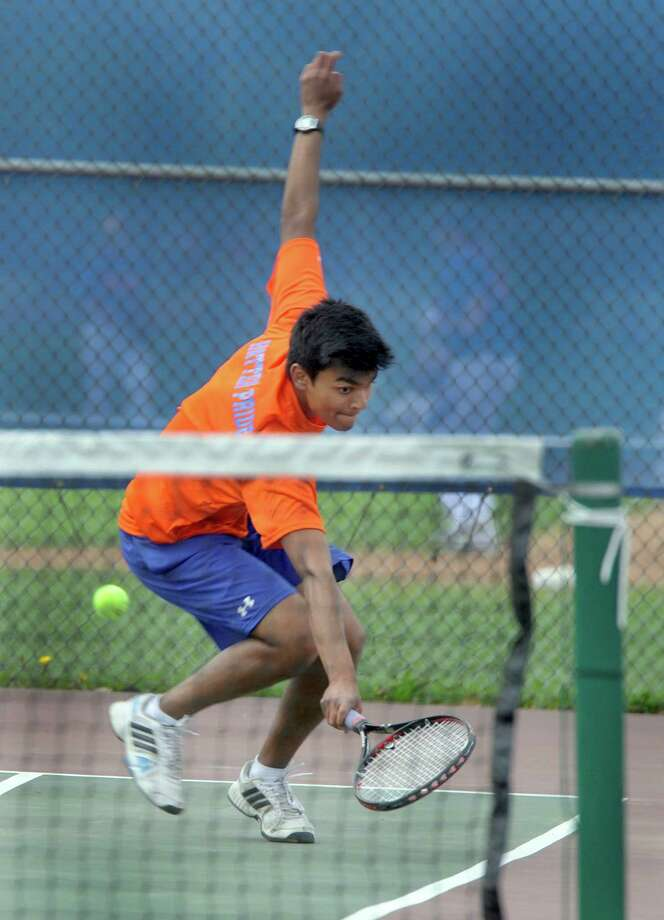 Mohit Patel, a senior at Danbury High School competes against a Trinity Catholic player. The Danbury, Conn. High School boys tennis team played Trinity Catholic of Stamford, at Danbury High Monday, May 19, 2014. Photo: Carol Kaliff / The News-Times