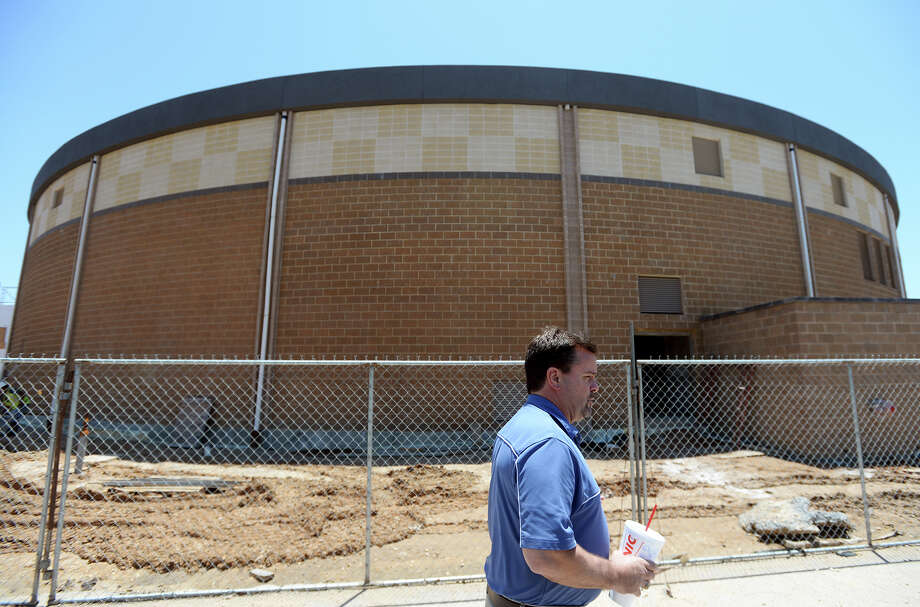 Ross Boothman, director of fine arts, walks past the FEMA Dome and Performing Arts Center construction site on Thursday afternoon. Construction continues on the Performing Arts Center and FEMA Dome in Lumberton on Thursday afternoon. Officials are hoping to raise $1.79 million to finish the project on time.  Photo taken Thursday 5/15/14 Jake Daniels/@JakeD_in_SETX Photo: Jake Daniels / ©2014 The Beaumont Enterprise/Jake Daniels