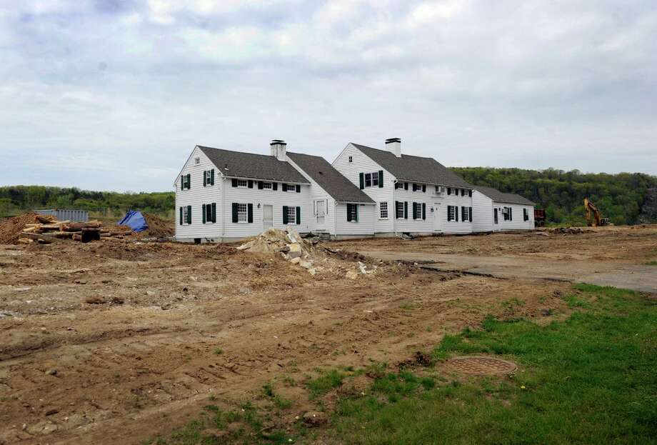 Construction work is under way on Laurel Hill Road in Brookfield, Conn. Tuesday, May 14, 2014, of a new incentive zoning apartment complex. The historic portion of this house will be relocated and will become part of a mixed-use part of the project. Photo: Carol Kaliff / The News-Times