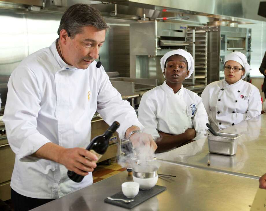 Spanish chef Joan Roca shows aspiring chefs how he and his brothers create a dining experience at his restaurant. Photo: Brett Coomer, Staff / © 2014 Houston Chronicle