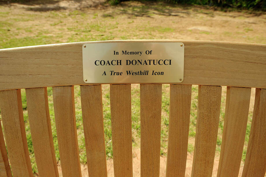 The memorial bench honoring former Westhill baseball coach Frank Donatucci was unveiled just beyond the left field fence at Westhill High School in Stamford, Conn., on Monday, May 19, 2014. Photo: Jason Rearick / Stamford Advocate