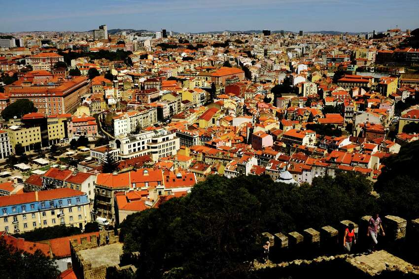 Red roofs and church spires dominate the skylines in May 2014, in Lisbon, Portugal.