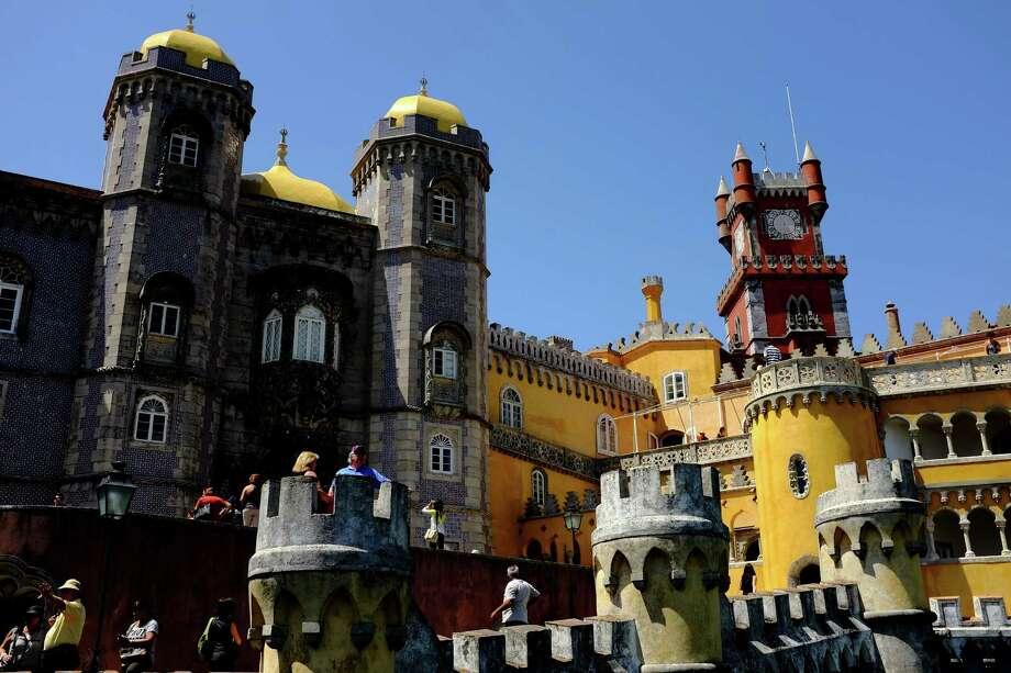 A view of the colorful Pena National Palace in May 2014, in Sintra, Portugal.  It is a national monument and constitutes one of the major expressions of 19th-century Romanticism in the world. The palace is a UNESCO World Heritage Site and one of the Seven Wonders of Portugal. Photo: JORDAN STEAD / JORDAN STEAD