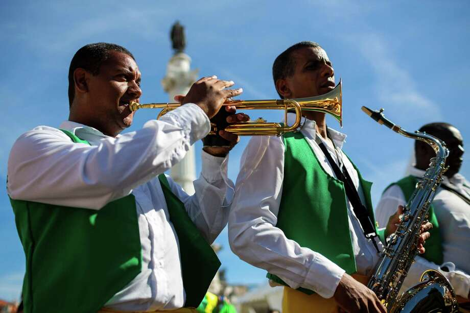 Musicians file through the streets during a parade in May 2014, in Lisbon, Portugal. Photo: JORDAN STEAD / JORDAN STEAD