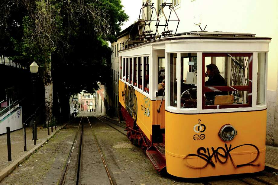 A yellow car awaits passengers as part of the Lisbon tramway network in May 2014, in Lisbon, Portugal. In operation since 1873, it presently comprises five urban lines. Photo: JORDAN STEAD / JORDAN STEAD