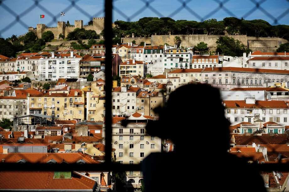 S‹o Jorge Castle, top left, as seen from the Santa Justa Lift in May 2014, in Lisbon, Portugal. Photo: JORDAN STEAD / JORDAN STEAD