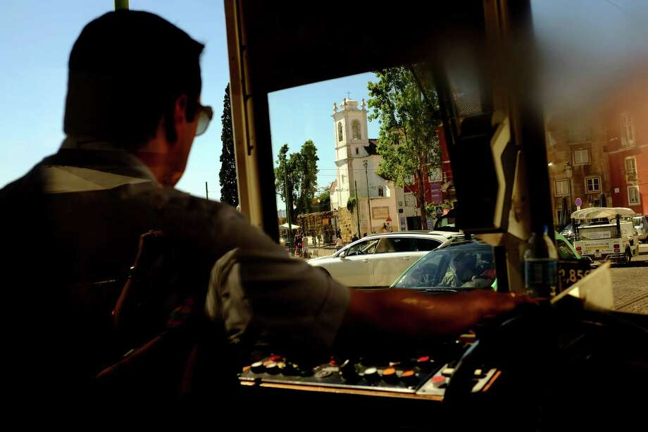 A driver pilots part of the Lisbon tramway network in May 2014, in Lisbon, Portugal. In operation since 1873, it presently comprises five urban lines. Photo: JORDAN STEAD / JORDAN STEAD