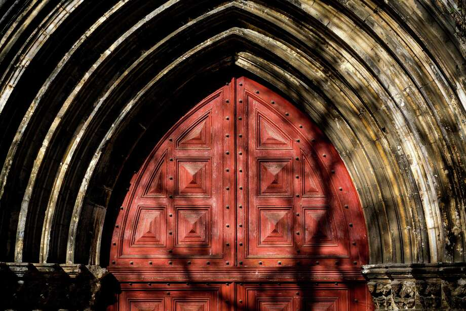 Evening light brings out the deep reds of a church door in May 2014, in Lisbon, Portugal. Photo: JORDAN STEAD / JORDAN STEAD