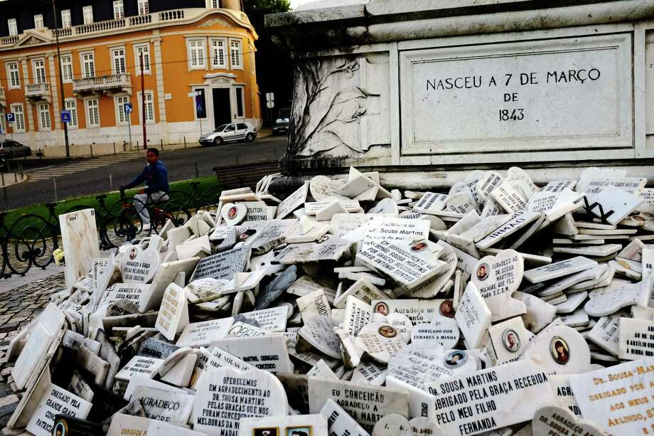 Marble plaques stack up around a statue of Dr JosŽ Tom‡s de Sousa Martins, a doctor renowned for his work amongst the poor, in May 2014, in Lisbon, Portugal. Photo: JORDAN STEAD / JORDAN STEAD