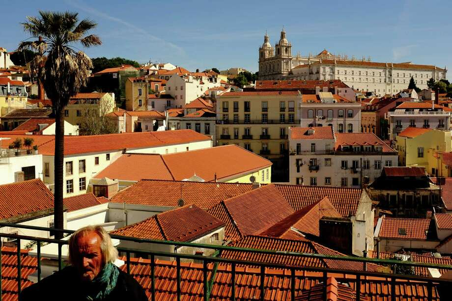 Red roofs and church spires dominate the skylines in May 2014, in Lisbon, Portugal. Photo: JORDAN STEAD / JORDAN STEAD