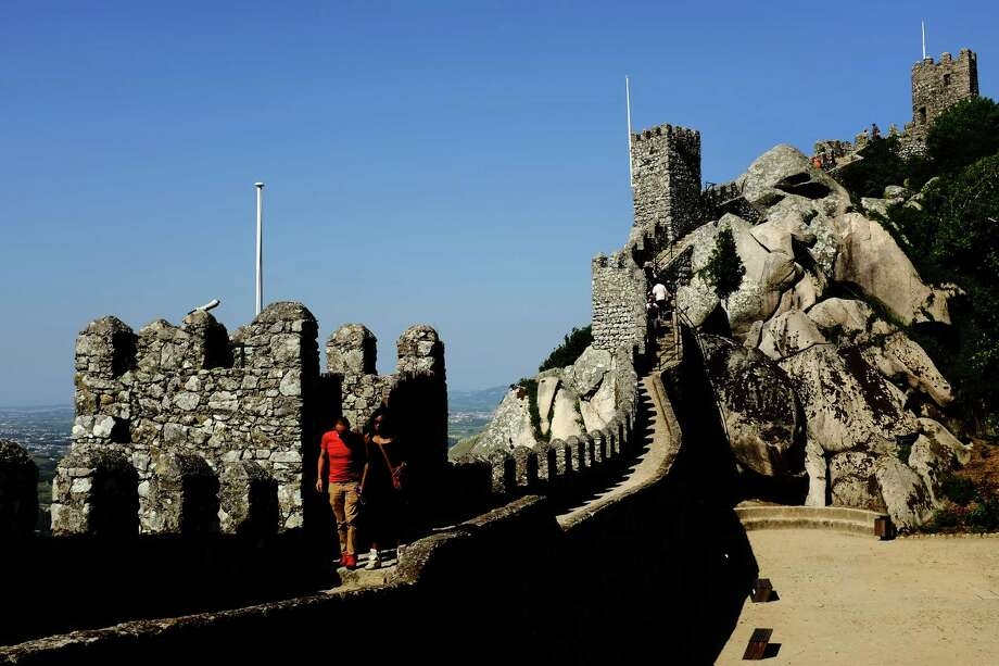 Tourists traverse the crumbling ruins of the Castle of the Moors in May 2014, in Sintra, Portugal. The castle was constructed during the 8th to 9th century. Photo: JORDAN STEAD / JORDAN STEAD