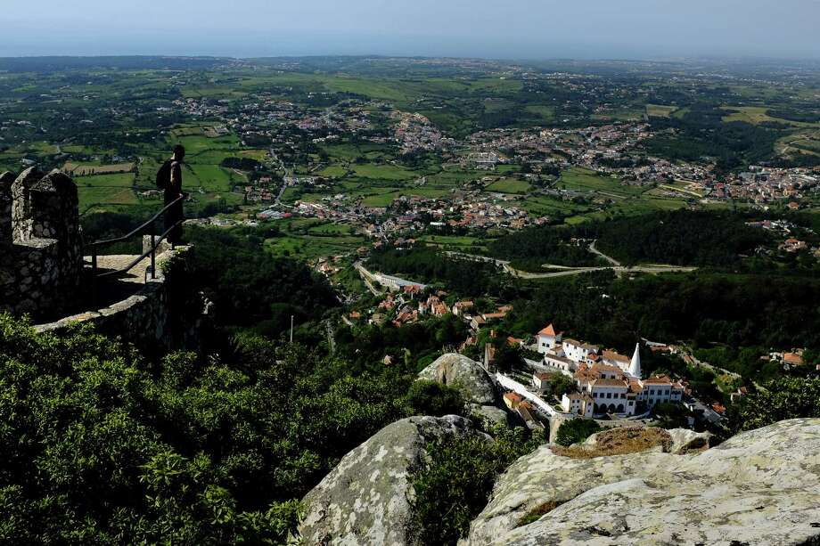 Tourists traverse heights of the crumbling ruins of the Castle of the Moors in May 2014, in Sintra, Portugal. The castle was constructed during the 8th to 9th century. Photo: JORDAN STEAD / JORDAN STEAD