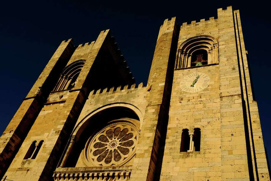 The oldest church in the city, Se Cathedral, glows in evening light in May 2014, in Lisbon, Portugal. Photo: JORDAN STEAD / JORDAN STEAD