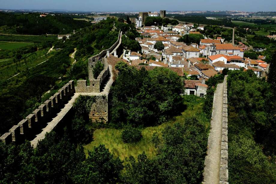 A wide view of Obidos, surrounded by a stone pathway, in May 2014, Portugal. Photo: JORDAN STEAD / JORDAN STEAD