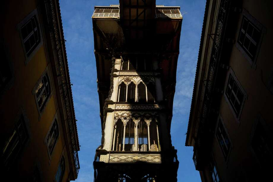 The Santa Justa Lift in May 2014, in Lisbon, Portugal. The structure connects the lower streets of the Baixa with the higher Largo do Carmo. Since its construction, the lift has become a tourist attraction. Photo: JORDAN STEAD / JORDAN STEAD