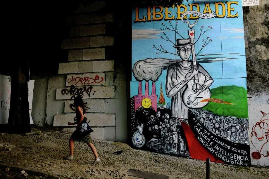 Street art colors the stone of a walkway in May 2014, in Lisbon, Portugal. Photo: JORDAN STEAD / JORDAN STEAD