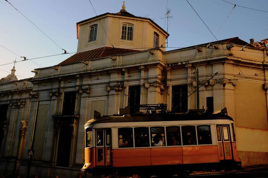 The Lisbon tramway network trundles by in May 2014, in Lisbon, Portugal. In operation since 1873, it presently comprises five urban lines. Photo: JORDAN STEAD / JORDAN STEAD