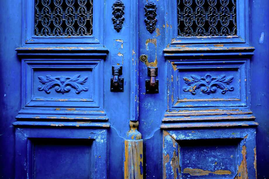 Cool blue stands out on the door of a personal residence in May 2014, in Lisbon, Portugal. Photo: JORDAN STEAD / JORDAN STEAD