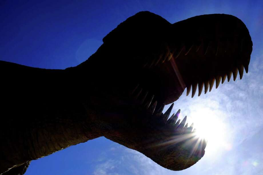 A life-size model of a Tyrannosaurus sits on the waterfront, home of the 1998 Lisbon World Exposition, as seen in May 2014, in Lisbon, Portugal. Photo: JORDAN STEAD / JORDAN STEAD