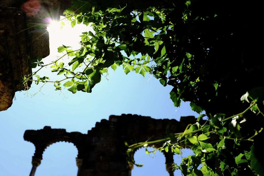 Ruins and foliage catch afternoon light at Evora, a UNESCO world heritage site in May 2014, in Portugal. Photo: JORDAN STEAD / JORDAN STEAD
