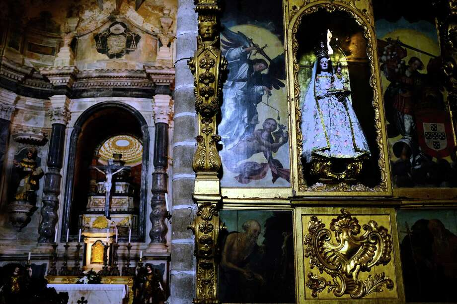 Gold and paintings decorate the inside of an all-stone church photographed in May 2014, in Evora, Portugal. Photo: JORDAN STEAD / JORDAN STEAD