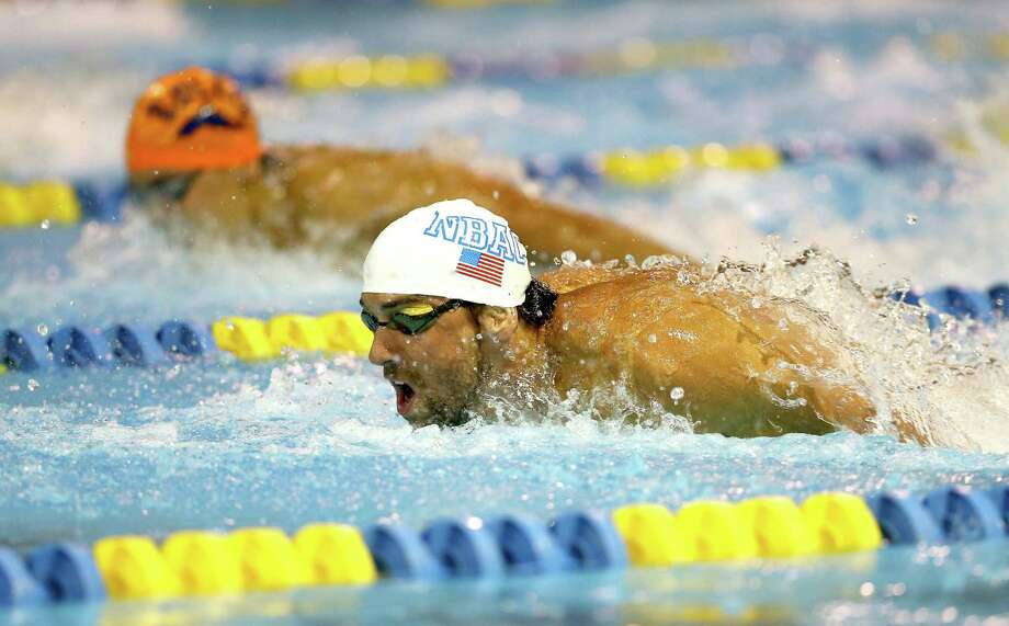 CHARLOTTE, NC - MAY 16:  Michael Phelps wins the men's 100m butterfly final during day 1 of the Arena Grand Prix at Charlotte at Mecklenburg County Aquatic Center on May 16, 2014 in Charlotte, North Carolina.  (Photo by Streeter Lecka/Getty Images) ***BESTPIX*** ORG XMIT: 491400397 Photo: Streeter Lecka / 2014 Getty Images