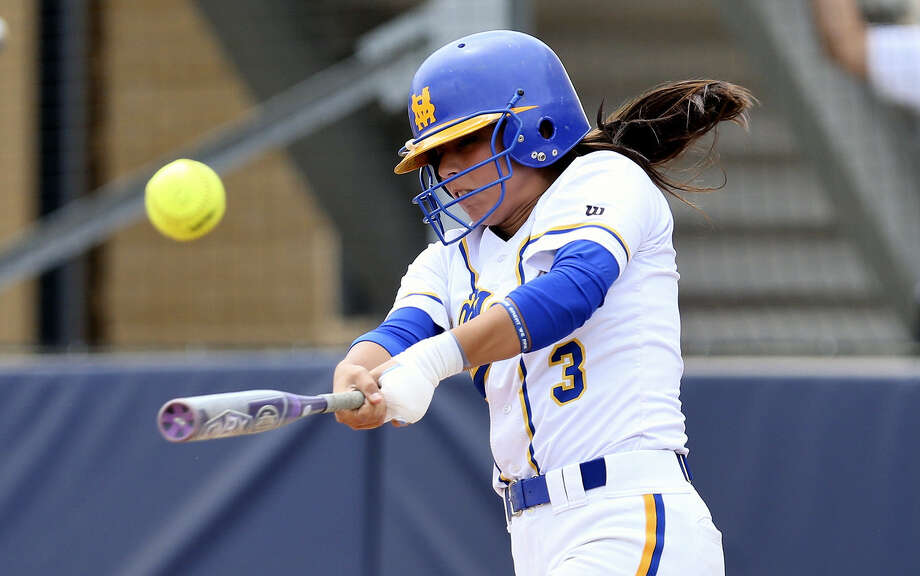 Amanda Villa of the St. Mary's University Rattlers softball team slams the ball squarely during a recent game in 2014. Photo: St. Mary's University