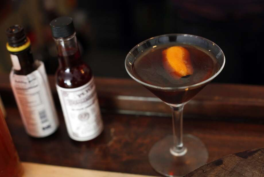 A barrel-aged Italian Manhattan with Rittenhouse rye, Luxardo Amaro, Campari, and Peychaud bitters at Oak and Rye in Los Gatos, Calif., on Wednesday, May 7, 2014. Photo: Sarah Rice, Special To The Chronicle