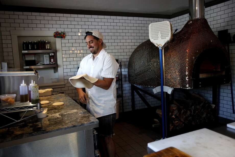 Angelo Womack, one of the owners, makes pizzas at Oak and Rye in Los Gatos, Calif., on Wednesday, May 7, 2014. Photo: Sarah Rice, Special To The Chronicle