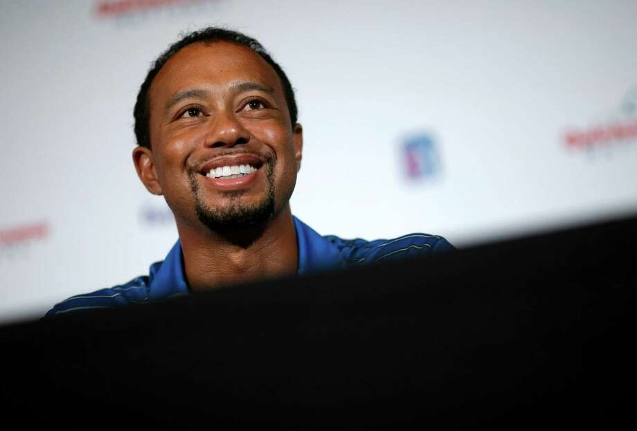 Golfer Tiger Woods speaks at a Quicken Loans National PGA tournament media day news conference at Congressional Country Club, Monday, May 19, 2014, in Bethesda, Md. Woods said his back injury was so debilitating that it caused him to doubt whether he would play golf again. While the surgery he had March 31 erased those doubts, he still has no timetable for his return. (AP Photo/Patrick Semansky) ORG XMIT: MDPS110 Photo: Patrick Semansky / AP