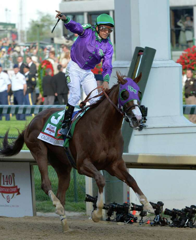 Victor Espinoza is jubilant after winning the 140th running of The Kentucky Derby aboard California Chrome Saturday evening May 3, 2014 in Louisville, Kentucky  (Skip Dickstein / Times Union) ORG XMIT: J=0504_derby Photo: SKIP DICKSTEIN