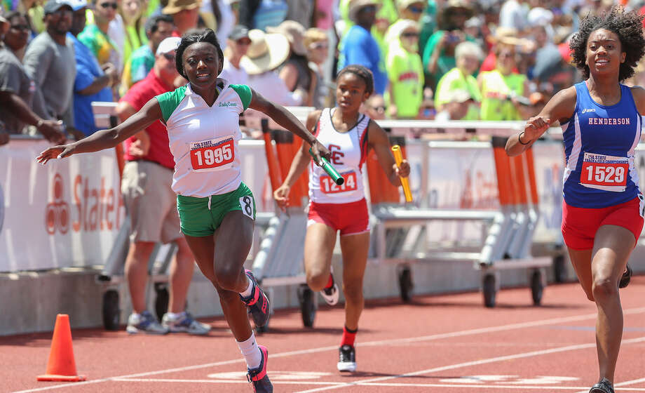 Sam Houston's Tashonna Williams, left, crosses the finish line in the 3A 400-meter relay during the UIL State track meet at Mike Myers Stadium in Austin on May 10. The Sam Houston team finished third in the event with a time of 3 minutes, 47.96 seconds. Photo: Marvin Pfeiffer / Southside Reporter / Express-News 2014