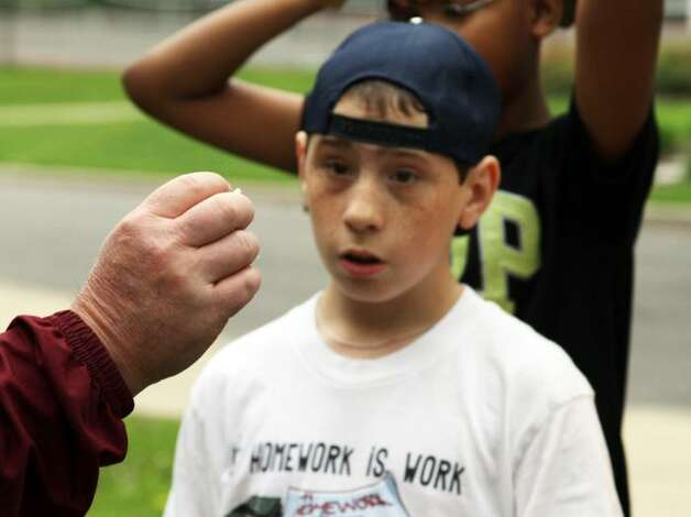 Sean Skoda, 11, was among a group of Pinewood Elementary School third-, fourth- and fifth-graders visiting Union College May 15 to learn how certain insects help the campus landscape. (Christen Gowan / Union College)