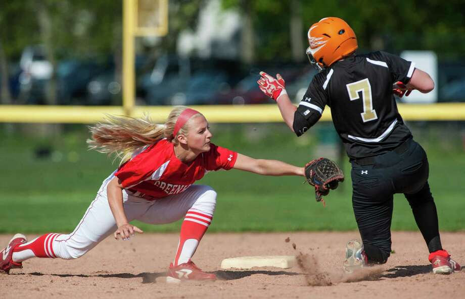 Greenwich high school shortstop Rebecca DeCarlo tries to tag out Trumbull high school's Harleigh Kaczegowicz at second base during a softball game played at Greenwich high school, Greenwich, CT on Monday, May, 19th, 2014 Photo: Mark Conrad / Connecticut Post Freelance