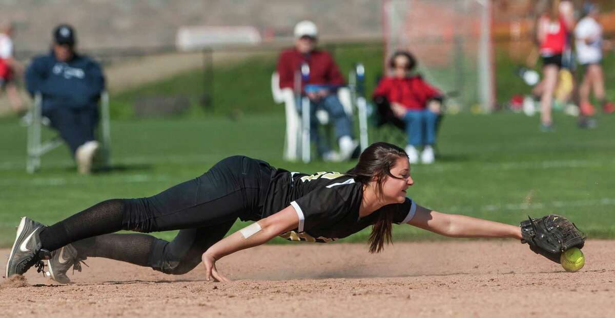 Trumbull high school shortstop Megan Thaler dives for an infield ground ball during a softball game against Greenwich high school played at Greenwich high school, Greenwich, CT on Monday, May, 19th, 2014.